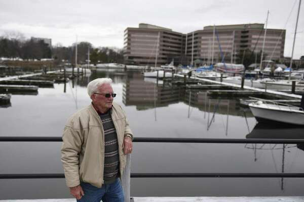 Stamford resident John Gilronan looks out onto the dock where he keeps his boat at Czescik Marina in Stamford, Conn. Monday, Feb. 19, 2018. After nearly two decades of docking his 17-foot boat at the public marina, Gilronan was surprised to hear of a new requirement forcing folks to get a certificate of liability insurance for at least $500,000, and that it had to list the city, its employees, agents and officers as insured.