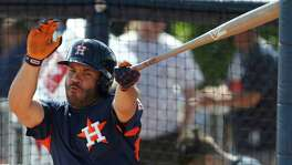 Houston Astros second baseman Jose Altuve (27) swings at a strike during live batting practice as full squad workouts began during spring training day at The Ballpark of the Palm Beaches, Monday, Feb. 19, 2018, in West Palm Beach    ( Karen Warren / Houston Chronicle )
