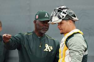 Oakland Athletics special instructor Dave Stewart, left, speaks with catcher Bruce Maxwell during a spring training baseball practice on Friday, Feb. 16, 2018 in Mesa, Ariz. (AP Photo/Ben Margot)