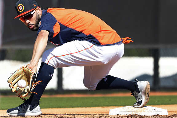 Houston Astros Marwin Gonzalez (9) catches a ground ball at third base during a drill as full squad workouts began during spring training day at The Ballpark of the Palm Beaches, Monday, Feb. 19, 2018, in West Palm Beach .