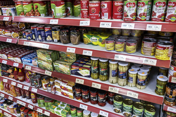 Shelves of tinned and jars of food for sale inside a supermarket in Toledo. (Photo by: