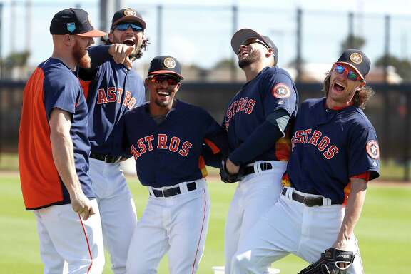 Houston Astros Derek Fisher (21), Jake Marisnick (6), Tony Kemp (18), George Springer (4), and Josh Reddick (22) laugh together as full squad workouts began during spring training day at The Ballpark of the Palm Beaches, Monday, Feb. 19, 2018, in West Palm Beach .