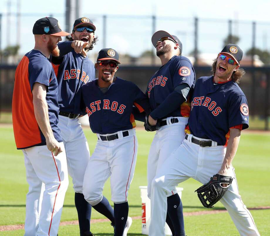 Houston Astros Derek Fisher (21), Jake Marisnick (6), Tony Kemp (18), George Springer (4), and Josh Reddick (22) laugh together as full squad workouts began during spring training day at The Ballpark of the Palm Beaches, Monday, Feb. 19, 2018, in West Palm Beach . Photo: Karen Warren, Houston Chronicle / © 2018 Houston Chronicle