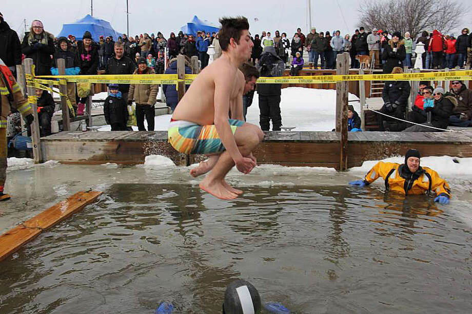 p.p1 {margin: 0.0px 0.0px 0.0px 0.0px; font: 12.0px Helvetica}The cold, frigid weather conditions didn't stop nearly 50 people from checking off an item on their bucket list and took on the Polar Bear Dip during Caseville's Shanty Days festival over the weekend. For those brave enough, the challenge was simple: Jump into really, really, really cold water. However, once each jumper got out the water, a relaxing hot tub was ready and waiting. Photo: Bradley Massman/Huron Daily Tribune