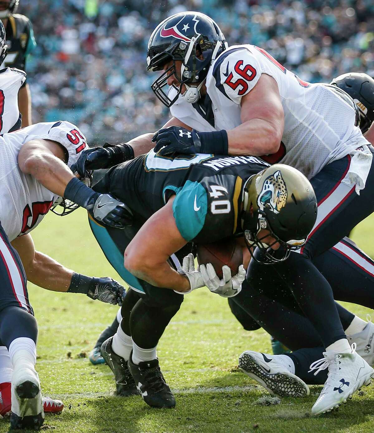 Jacksonville Jaguars fullback Tommy Bohanon (40) runs into the end zone past Houston Texans inside linebackers Dylan Cole (51) and Brian Cushing (56) for a 1-yard touchdown run during the third quarter of an NFL football game at EverBank Field on Sunday, Dec. 17, 2017, in Jacksonville. ( Brett Coomer / Houston Chronicle )