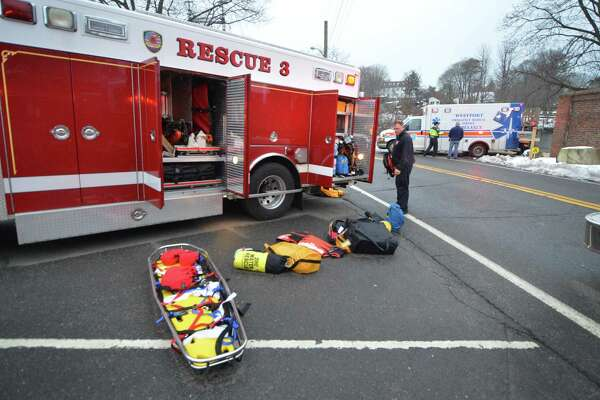 An ambulance leaves from a Stoney Point residence for Norwalk Hospital with a person who was pulled from the Saugatuck River after jumping from the I-95 bridge on Monday February 19, 2018 in Westport Conn.