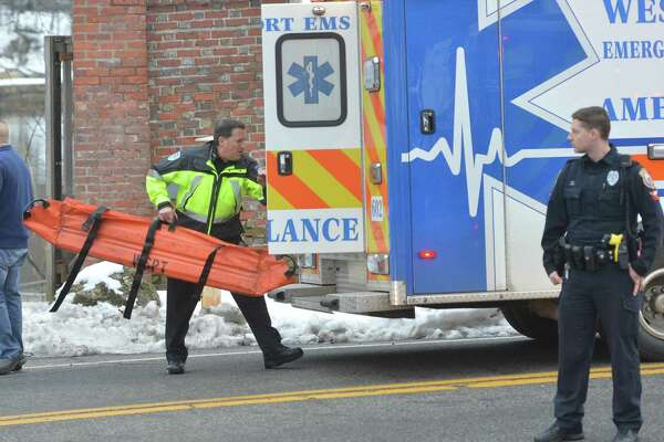 A Westport Paramedic loads recue equipment into a Westport Ambulance after a person was pulled from the Saugatuck River after jumping from the I-95 bridge on Monday February 19, 2018 in Westport Conn.