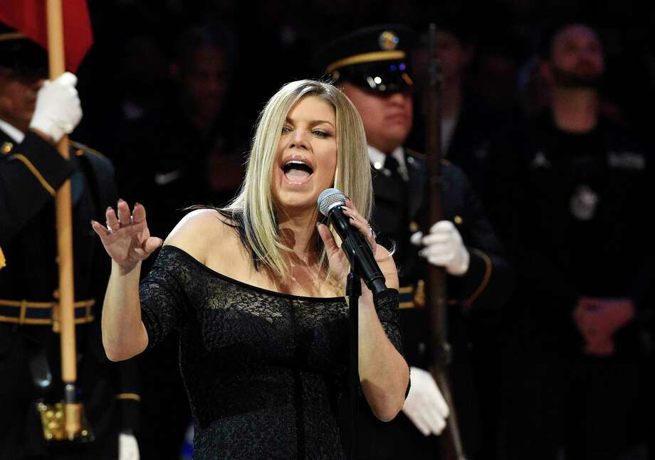 Singer Fergie took a bluesy approach to the national anthem prior to the NBA All-Star basketball game. Photo: Chris Pizzello, STF / Copyright 2018 The Associated Press. All rights reserved.