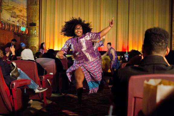 Kendra Bowman, 17, of the Berkeley High School Afro-Haitian Dance performs before a screening of Black Panther at the Grand Lake Theater Monday, Feb. 19, 2018, in Oakland, Calif.