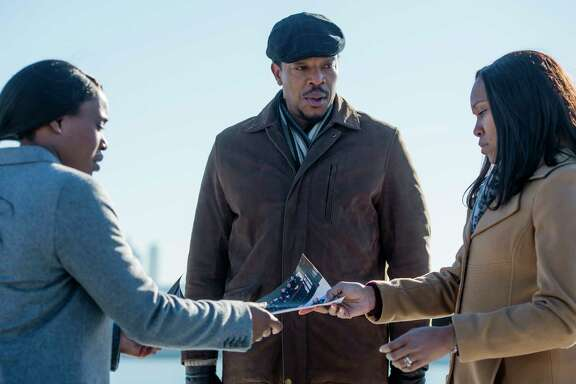"Clare-Hope Ashitey, left, Russell Hornsby and Regina King star in the Netflix series ""Seven Seconds."""