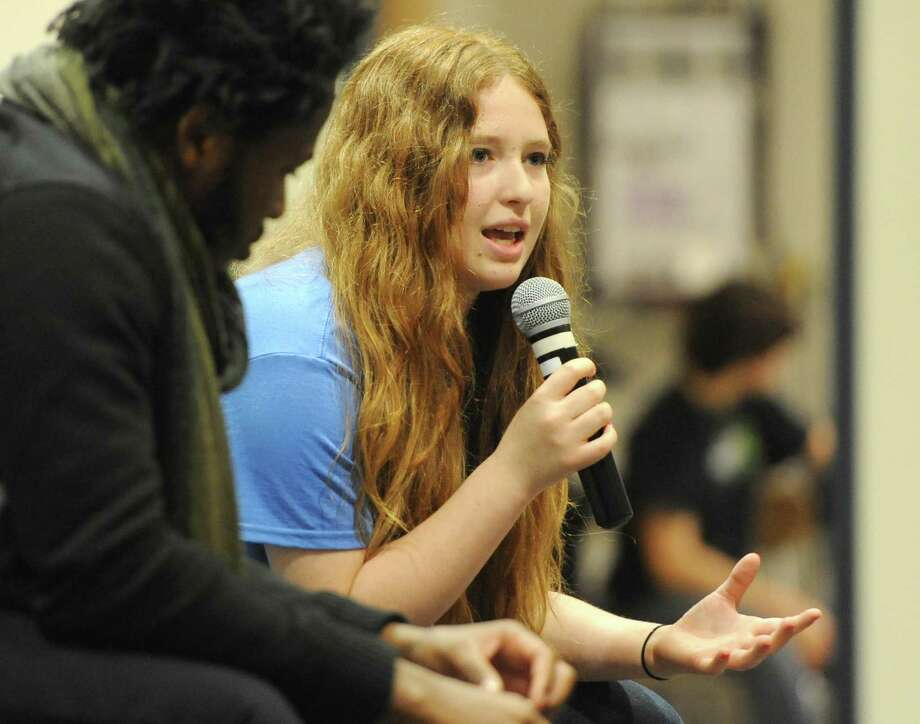 Newtown High School student activist Sarah Clements speaks during the story exchange at the Honor With Action Youth Leadership Summit on Gun Violence Prevention at Newtown High School in Newtown, Conn. Saturday, May 24, 2014.  The summit featured keynote speaker Ishmael Beah, a Sierra Leonean best-selling author and human rights activist.  The event included many large group activities and small workshops such as story exchange, a young activist panel, a movie about Virginia Tech shooting survivor Colin Goddard, healing through the arts, and breakout sessions about spirituality and mental health.  About 100 children from across the state and Harlem, N.Y. attended the summit. Photo: Tyler Sizemore / Tyler Sizemore / The News-Times