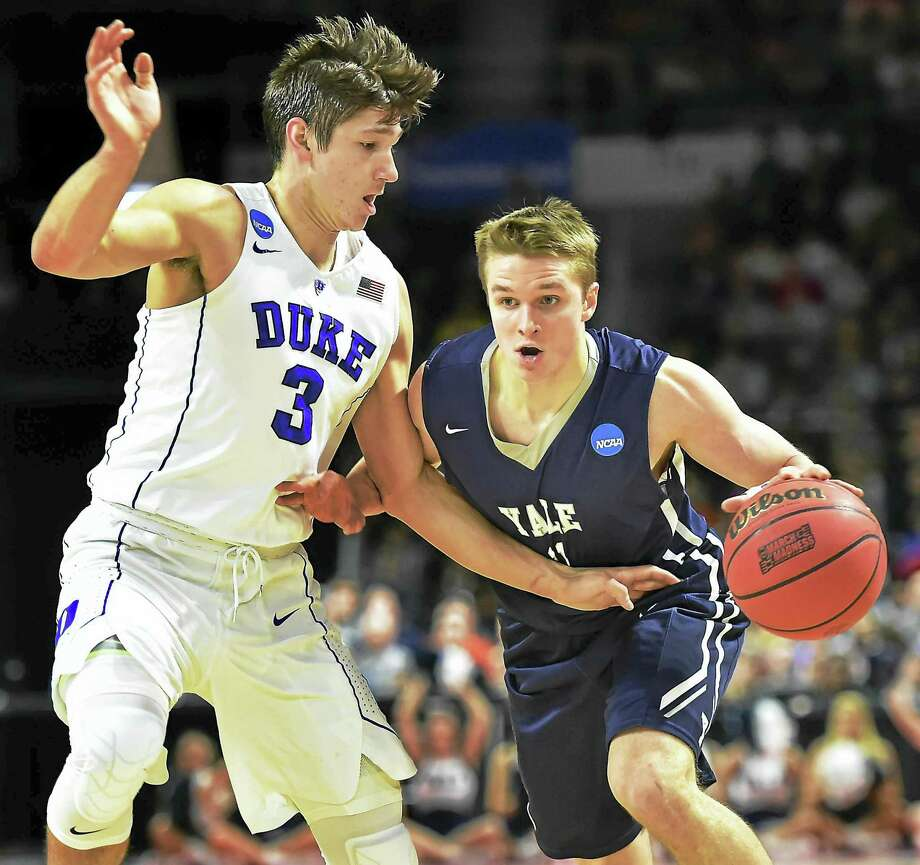 Yale's Makai Mason is defended by Duke's Grayson Allen during the 2016 NCAA tournament. Mason returned to the court for the Bulldog for the first time since that game on Saturday. Photo: Catherine Avalone / Hearst Connecticut Media File Photo / New Haven RegisterThe Middletown Press