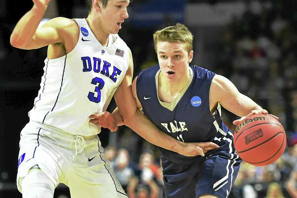 Yale's Makai Mason is defended by Duke's Grayson Allen during the 2016 NCAA tournament. Mason returned to the court for the Bulldog for the first time since that game on Saturday.