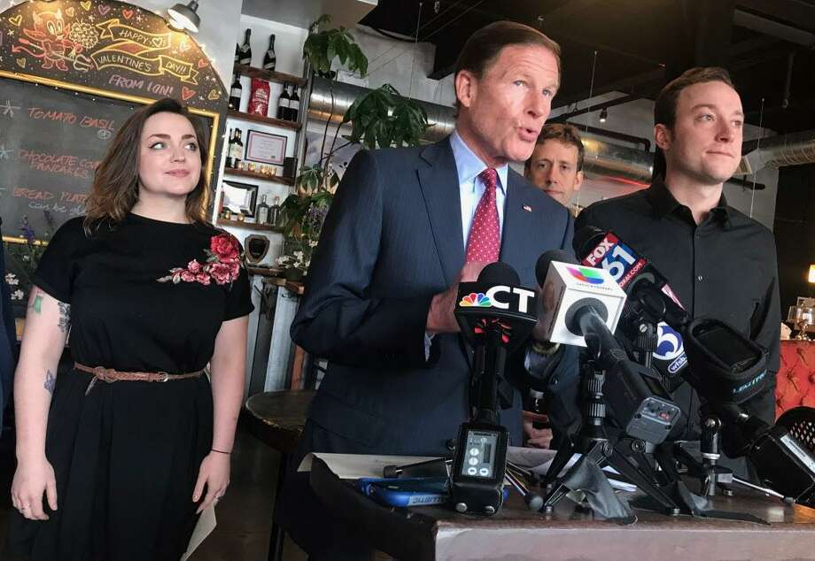 From left, ION Restaurant server Sara Dodge, U.S. Sen. Richard Blumenthal, state Rep. Matt Lesser and server Matt Banta speak during a press conference Monday at the Main Street eatery about a rule on tip regulations proposed by the U.S. Department of Labor. If enacted, it would allow workplaces to share tips among more employees in an effort to help decrease wage disparities between tipped and non-tipped workers. Photo: Cassandra Day / Hearst Connecticut Media
