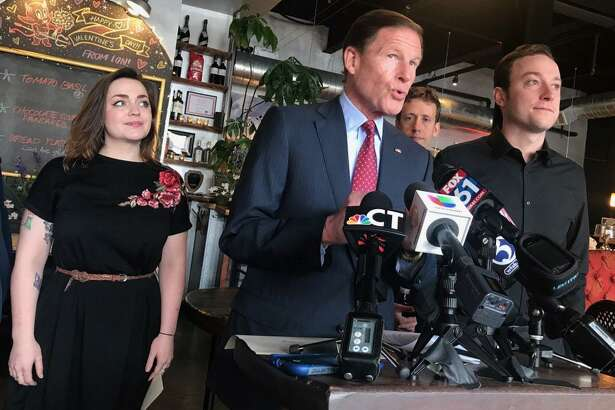 From left, ION Restaurant server Sara Dodge, U.S. Sen. Richard Blumenthal, state Rep. Matt Lesser and server Matt Banta speak during a press conference Monday at the Main Street eatery about a rule on tip regulations proposed by the U.S. Department of Labor. If enacted, it would allow workplaces to share tips among more employees in an effort to help decrease wage disparities between tipped and non-tipped workers.