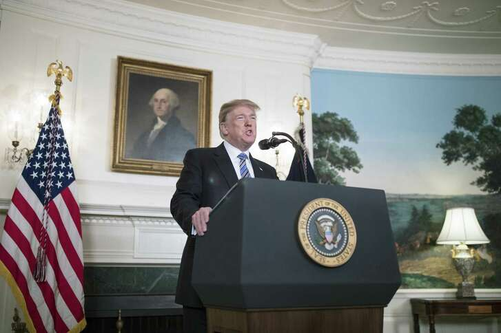 President Donald Trump delivers a statement about the South Florida high school shooting that occurred a day earlier, from the White House on Thursday. He talked about mental illness, but not guns.