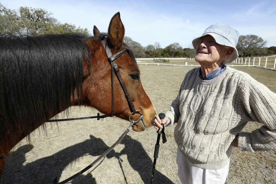 Alison Ramos stands next to Kheck, an Arabian therapy horse, as she talks to Kheck's rider, Kyla Nelson, during a ride at Triple H Equitherapy Center in Pipe Creek. Photo: William Luther /San Antonio Express-News / © 2018 San Antonio Express-News