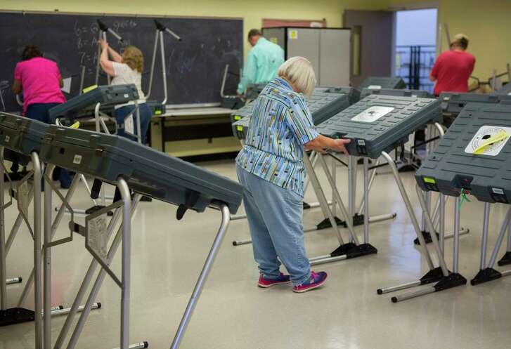Volunteers set up voting machines for early voting at the West Gray Metropolitan Multi-Service Center, Monday, Feb. 19, 2018, in Houston.  ( Mark Mulligan / Houston Chronicle )