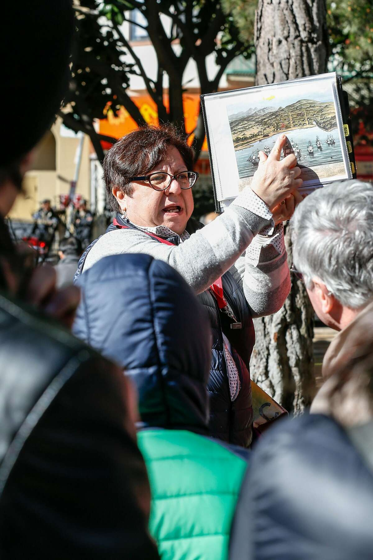 City Walks tour guide Nancy Rios gives a tour through Chinatown on Monday, February 19, 2018 in San Francisco, California.