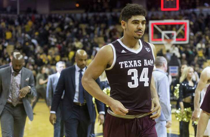Texas A&M's Tyler Davis walks off the court with his team after they lost 62-58 to Missouri in an NCAA college basketball game Tuesday, Feb. 13, 2018, in Columbia, Mo. (AP Photo/L.G. Patterson)