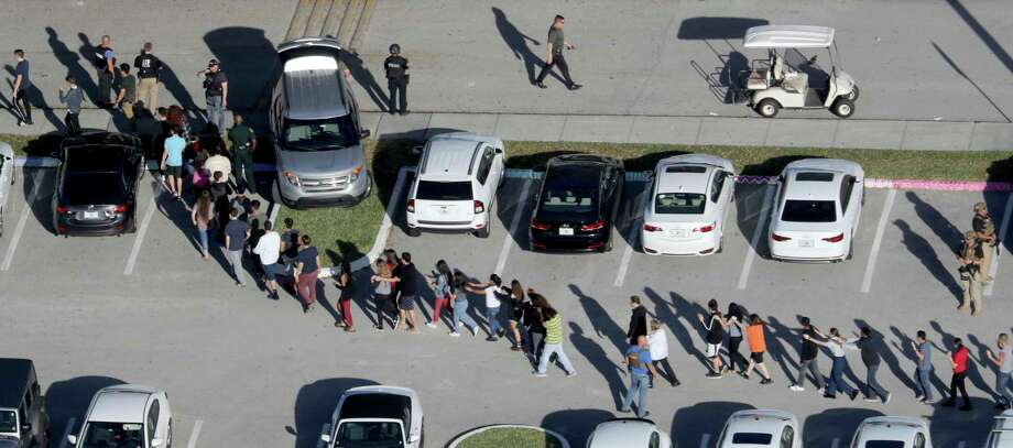 Students are evacuated by police from Marjory Stoneman Douglas High School in Parkland, Fla., after a shooter opened fire on the campus. (Mike Stocker/South Florida Sun-Sentinel) Photo: Mike Stocker, MBO / Sun Sentinel 2018