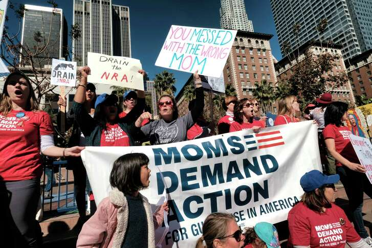 Mothers join a rally against gun violence in Los Angeles on Monday. Hundreds demanded tougher background checks and other measures after last week's deadly school shooting.