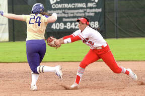 Lamar's Kelly Meeuwsen fields the grounder and goes forthe double play tagging Washington's Emma Helm in the first of Monday's home opening doubleheader games. Photo taken Monday, February 19, 2018 Kim Brent/The Enterprise