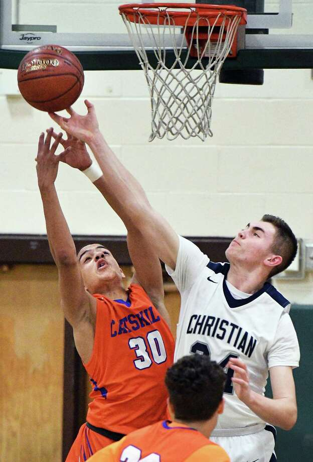 Catskill's #Justice Brantley, left, and Mekeel Christian's #34 Dan McCarty vie for a rebound during their Class B quarterfinal at Shenendehowa High Friday Feb. 24, 2017 in Clifton Park, NY.  (John Carl D'Annibale / Times Union) Photo: John Carl D'Annibale / 20039777A