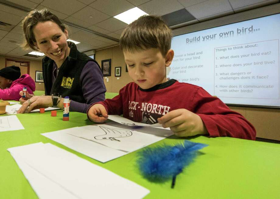 Jennifer Jaskolka works with her four year old son Samuel to design a bird using feathers and other crafts at the Albany Pine Bush Preserve Discovery Center during the build a bird program Monday Feb. 19, 2018 in Albany, N.Y.   (Skip Dickstein/Times Union) Photo: SKIP DICKSTEIN / 20042958A