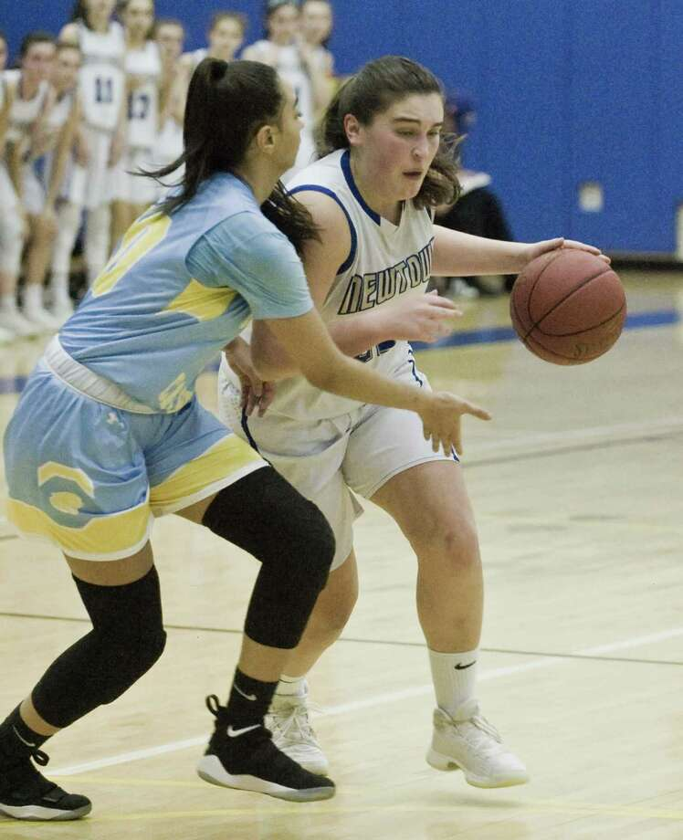 Kolbe Cathedral High School's Beatriz Honorio tries to block Newtown High School's Nicole DaPra in the SWC Girls basketball semifinal at Newtown. Monday, Feb. 19, 2018 Photo: Scott Mullin / For Hearst Connecticut Media / The News-Times Freelance