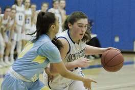Kolbe Cathedral High School's Beatriz Honorio tries to block Newtown High School's Nicole DaPra in the SWC Girls basketball semifinal at Newtown. Monday, Feb. 19, 2018