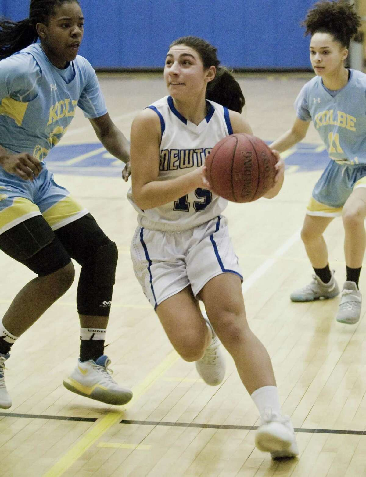 Newtown High School's Jacquelyn Matthews heads to the basket in the SWC Girls basketball semifinal against Kolbe Cathedral High School, played at Newtown. Monday, Feb. 19, 2018