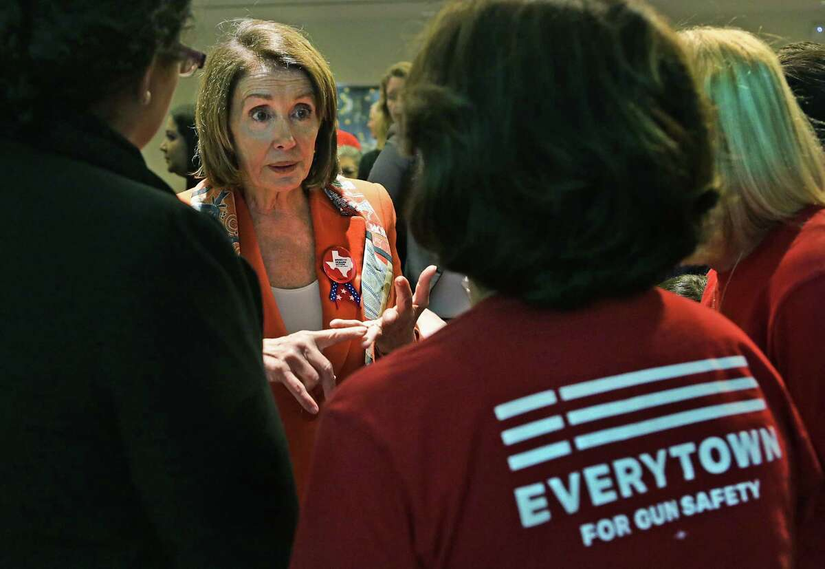 U.S. House Democratic Leader Nancy Pelosi speaks with members of Moms Demand Action San Antonio Chapter following a discussion with Congressman Joaquin Castro about the recently passed Tax Bill, at the San Antonio Central Public Library on Monday, Feb. 19, 2018.