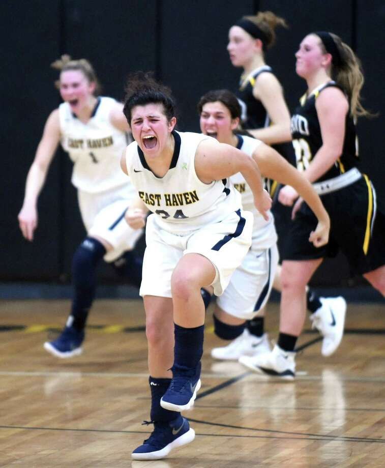 East Haven's Alexis Pendziwater, center, celebrates the Yellow Jackets' win over Hand in the SCC semifinals in Milford on Monday. Photo: Arnold Gold / Hearst Connecticut Media / New Haven Register