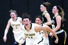 East Haven's Alexis Pendziwater, center, celebrates the Yellow Jackets' win over Hand in the SCC semifinals in Milford on Monday.