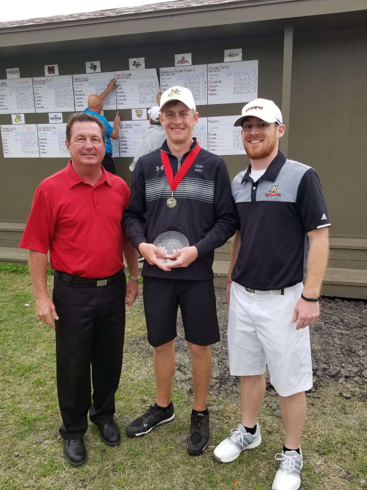 Midland College's Callum Bruce, center, holds his award for winning the Claude Jacobs Invitational in Victoria Monday. Courtesy photo
