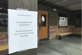 A sign at the Texas Roadhouse indicates the restaurant was closed on Monday. A shooting outside the restaurant left five people wounded Sunday night.