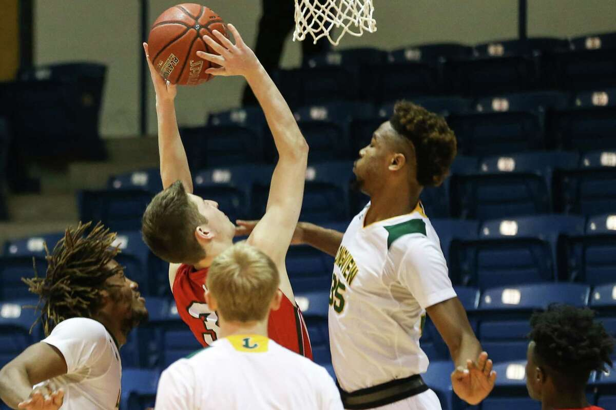 The Woodlands' Patrick Oed (30) shoots as Longview's Jason Bush Jr. (35) defends during the boys basketball game on Monday, Feb. 19, 2018, at Angelina College in Lufkin. (Michael Minasi / Houston Chronicle)