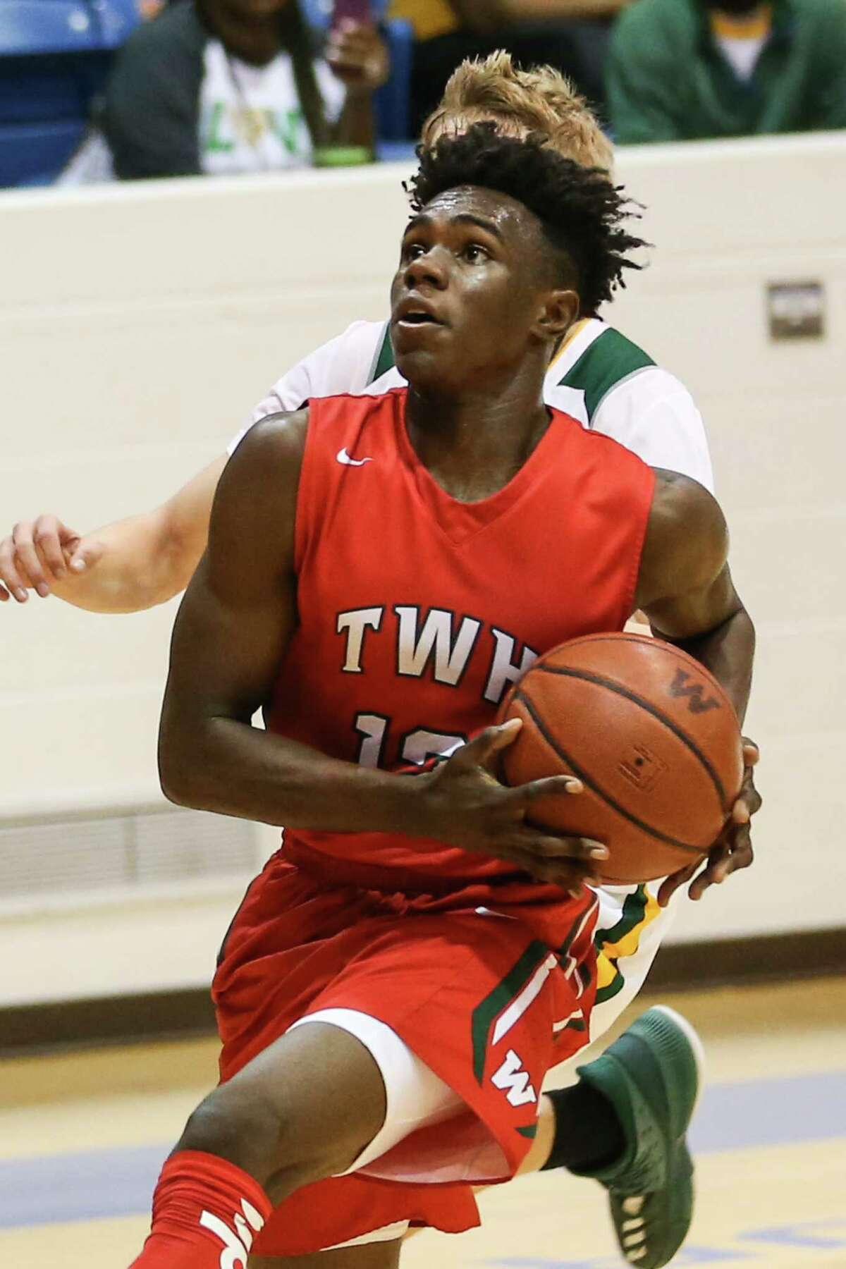 The Woodlands' KeSean Carter (12) drives for the basket during the boys basketball game against Longview on Monday, Feb. 19, 2018, at Angelina College in Lufkin. (Michael Minasi / Houston Chronicle)