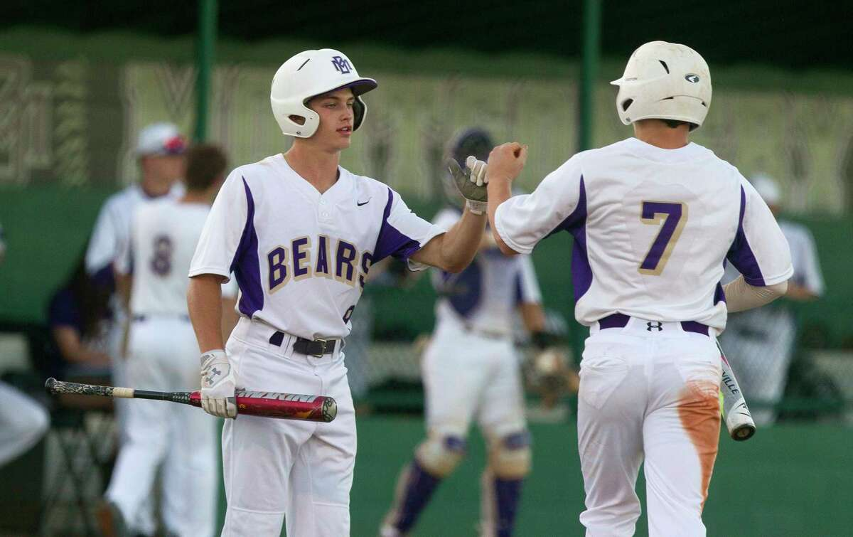 Montgomery's Ben Shields (7) gets a high-five from Alex Nunn (9) after scoring on an RBI single by Gavin LaBruyere during the second inning of a District 12-6A high school baseball game at Montgomery Athletic Complex on Thursday, March 30, 2017, in Montgomery.