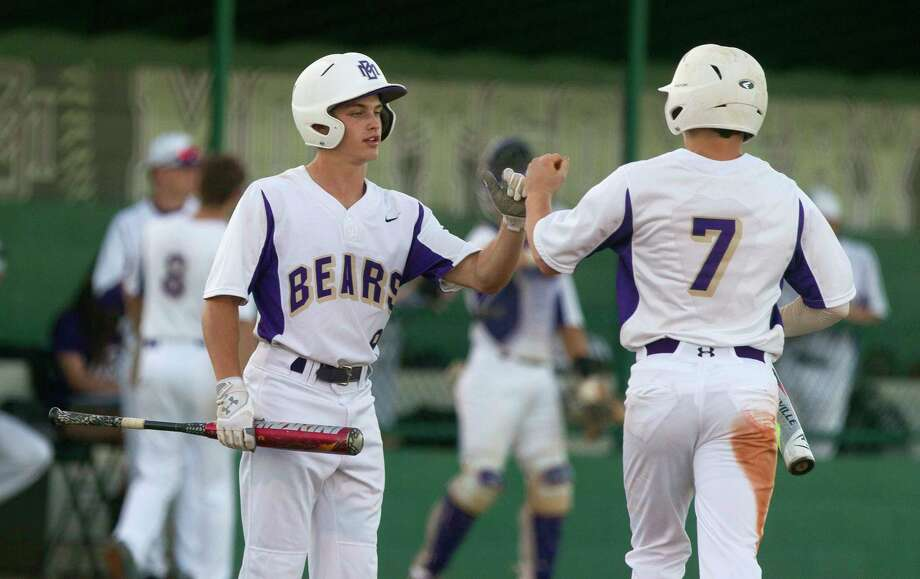 Montgomery's Ben Shields (7) gets a high-five from Alex Nunn (9) after scoring on an RBI single by Gavin LaBruyere during the second inning of a District 12-6A high school baseball game at Montgomery Athletic Complex on Thursday, March 30, 2017, in Montgomery. Photo: Jason Fochtman, Staff Photographer / © 2017 Houston Chronicle