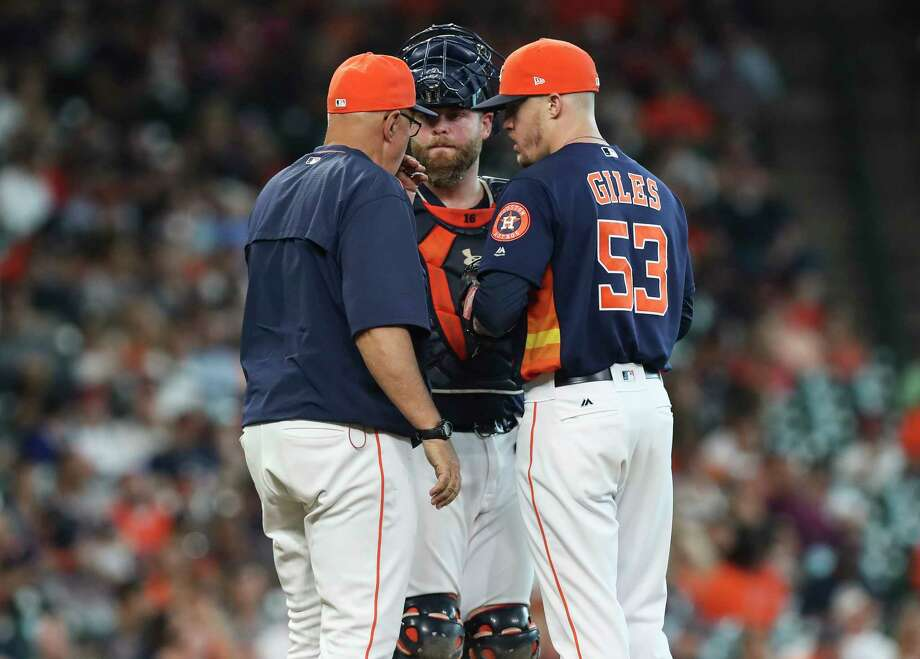 Houston Astros manager A.J. Hinch (14) and catcher Brian McCann (16) visit the mound after relief pitcher Ken Giles (53) allowed Minnesota Twins second baseman Brian Dozier hit a single and walked designated hitter Robbie Grossman as he relieved Chris Devenski during the top ninth inning of the game at Minute Maid Park Sunday, July 16, 2017, in Houston. Houston Astros defeated Minnesota Twins 5-3.( Yi-Chin Lee / Houston Chronicle ) Photo: Yi-Chin Lee, Staff / © 2017  Houston Chronicle