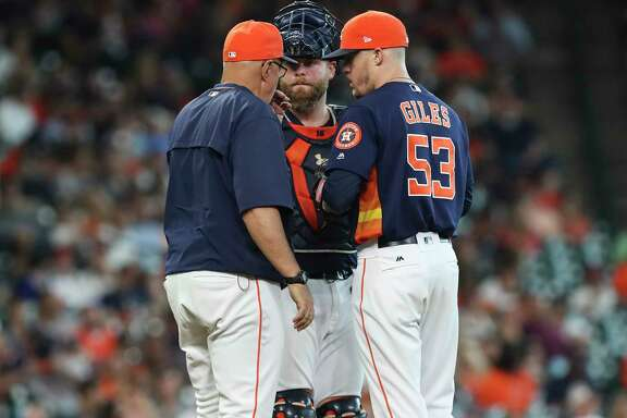Houston Astros manager A.J. Hinch (14) and catcher Brian McCann (16) visit the mound after relief pitcher Ken Giles (53) allowed Minnesota Twins second baseman Brian Dozier hit a single and walked designated hitter Robbie Grossman as he relieved Chris Devenski during the top ninth inning of the game at Minute Maid Park Sunday, July 16, 2017, in Houston. Houston Astros defeated Minnesota Twins 5-3.( Yi-Chin Lee / Houston Chronicle )