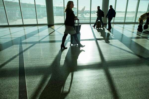 Travelers walk towards the baggage claim at William P. Hobby Airport, Monday, Jan. 29, 2018, in Houston. ( Mark Mulligan / Houston Chronicle )
