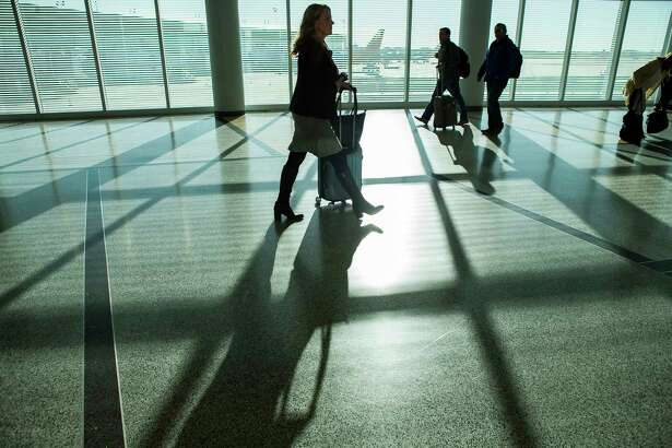 Travelers walk towards the baggage claim at William P. Hobby Airport, Monday, Jan. 29, 2018, in Houston. ( Mark Mulligan / Houston Chronicle )