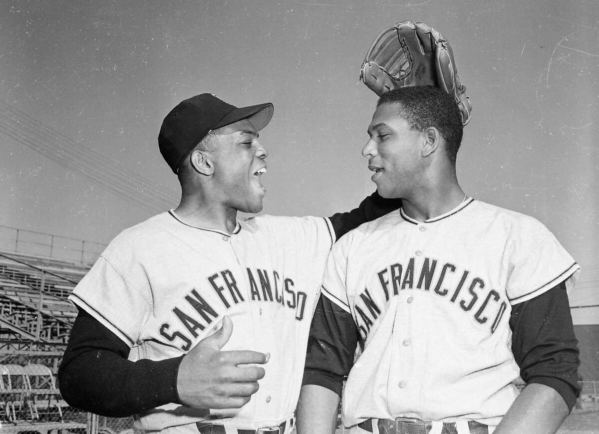 (Original Caption) A pat on the head from outfielder Willie Mays, (L), greets San Francisco Giants first baseman Orlando Cepeda as the latter reported for his first workout at the Giants spring training camp here.