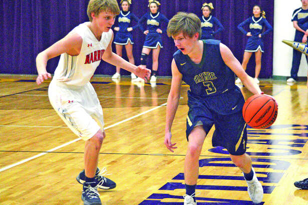 Father McGivney sophomore Kellen Weir, right, tries to get past a Hardin Calhoun defender during the second quarter of Monday's first-round game at the Class 1A Mount Olive Regional.