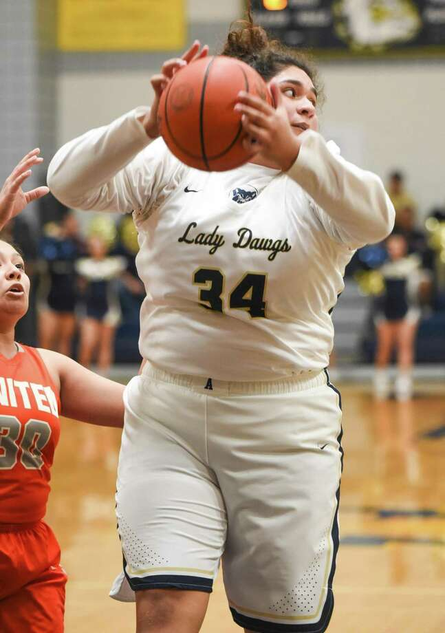 Yuli Zamora and Alexander advanced to the regional semifinals with a 68-63 win Monday over rival United. Photo: Danny Zaragoza /Laredo Morning Times