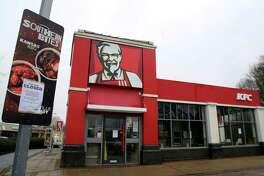 """A closed sign is seen outside a KFC restaurant near Ashford, England, Monday, Feb. 19, 2018. Fast-food chain KFC has been forced to close most of its 900 outlets in Britain and Ireland because of a shortage of chicken The company is blaming """"teething problems"""" with its new delivery partner, DHL. The company first apologized for the problems on Saturday. In an update Monday, it listed more than 200 stores as open, but did not say when the rest might reopen. (Gareth Fuller/PA via AP"""