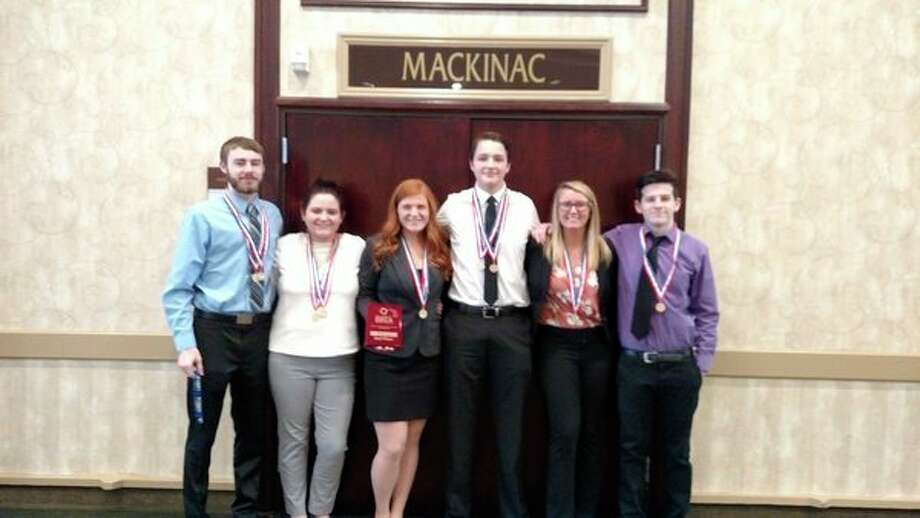 The six Saginaw Valley State University students who qualified to travel to Washington, D.C., for the national DECA competition in April are, from left, Jacob Saint Amour, Maggie Walker, Mackenzie Koski, Keegan Booms, Carly D'Alessandro and Jacob Humphries. (Photo provided)